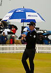 Luke Donald makes his way to the players lounge again as the range is closed with  another approaching storm to further delay the conclusion of the second round  of the Barclays Scottish Open, played over the links at Castle Stuart, Inverness, Scotland from 7th to 10th July 2011:  Picture Stuart Adams /www.golffile.ie 9th July 2011