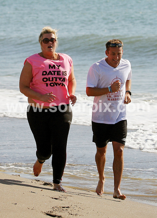 **ALL ROUND PICTURES FROM SOLARPIX.COM**                                 **WORLDWIDE SYNDICATION RIGHTS**                   Caption:  Towie's James Argent,Joe Essex & Gemma Collins out running this morning on the beach in Marbella with their personal trainers..Gemma looked a little worse for wear as she had to hang on to her trainer when she ran out of steam half way..  This pic:. Gemma Collins   & trainer                                                                                        JOB REF:14583        AB1       DATE:20.03.2012                                                             **MUST CREDIT SOLARPIX.COM OR DOUBLE FEE WILL BE CHARGED**                                                                        **MUST NOTIFY SOLARPIX OF ONLINE USAGE**                 **CALL US ON: +34 952 811 768 or LOW RATE FROM UK 0844 617 7637**