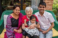Nepal, Kathmandu. Nepal, Kathmandu. Rajan Pandit, NYF HR manager, and family with Olga Murray.