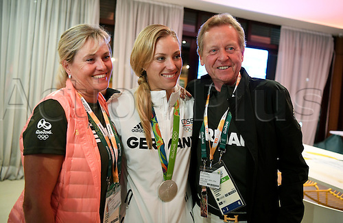 14.08.2016. Rio de Janeiro, Brazil. Silver medalist, tennis player Angelique Kerber (C) of Germany pose German physiotherapist Ursula Eder and physiotherapist Klaus Eder at the Deutsche Haus (German House) in Barra during the Rio 2016 Olympic Games in Rio de Janeiro, Brazil, 14 August 2016.