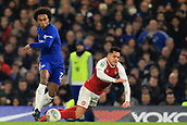 10th January 2018, Stamford Bridge, London, England; Carabao Cup football, semi final, 1st leg, Chelsea versus Arsenal; Willian of Chelsea fouls Alexis Sanchez of Arsenal