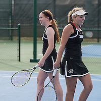 STAFF PHOTO ANTHONY REYES &bull; @NWATONYR<br /> Mallory Tabler, left, and doubles partner Kendra Dinsmore, both of Bentonville, celebrate a point during the 7A-West Conference girls tennis tournament Wednesday, Oct. 8, 2014 at the Springdale Har-Ber tennis courts.