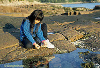 ON03-018z  Ocean - girl exploring tidepool on rocky beach - Acadia National Park, Maine