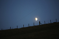 2017 10 30 Moon rising over a farm fence, Llangammarch Wells, Wales, UK