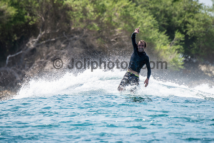 Four Seasons,Kuda Huraa, Maldives (Monday, August 3, 2015) Neco Padaratz (BRA) riding a Twin Fin. The swell was out of the South East today with waves in the 2'-3' range and  clean conditions. There was a surf session at Honkeys this morning with Neco Padaratz (BRA) and Shane Dorian (HAW), competitors in the Four Seasons Maldives Surfing Champions Trophy using the session s a warm up. There was very a light West South West wind with very good conditions. <br /> There was also a session at Ninjas in the afternoon.  Photo: joliphotos.com