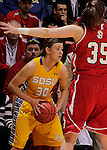 SIOUX FALLS, SD - MARCH 12:  Ashley Eide #30 of South Dakota State looks for a teammate while pressured by Nicole Seekamp #35 of the University of South Dakota during their championship game at the 2013 Summit League Tournament at the Sioux Falls Arena Tuesday. (Photo by Dick Carlson/Inertia)