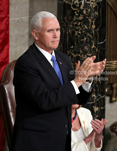 United States Vice President Mike Pence stands and applauds as US President Donald J. Trump delivers his second annual State of the Union Address to a joint session of the US Congress in the US Capitol in Washington, DC on Tuesday, February 5, 2019.<br /> Credit: Alex Edelman / CNP
