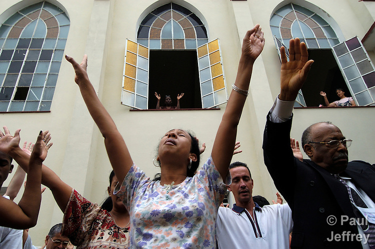 At a Methodist Church in Havana, Cuba, worshippers raise their hands while praying. Since becoming an officially secular state in the early 1990s, Cuba has seen steady growth of its Christian community.