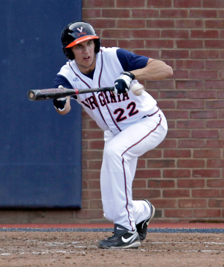 Virginia infielder Daniel Pinero (22) bunts the ball during the game against James Madison University Tuesday in Charlottesville, VA.  Photo/The Daily Progress/Andrew Shurtleff