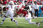 Wisconsin Badgers defensive back Latrell Jamerson (12) pressures Florida Atlantic Owls punt returner Henry Bussey III (1) during an NCAA College Football game Saturday, September 9, 2017, in Madison, Wis. The Badgers won 31-14. (Photo by David Stluka)