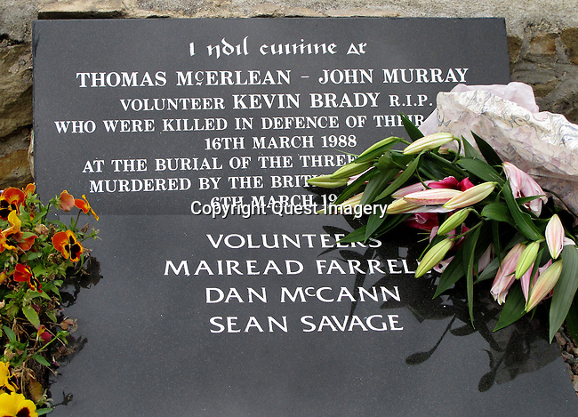 The three people on the bottom head stone were killed in Gibraltar in 1988 by the the British Army Special Air Service, SAS, It was at their funeral in Milltown cemetery loyalist gunman Michael Stone launched a gun and grenade attack killing the other 3 named on the top headstone in the 'New' Republican plot at Milltown Cemetery in Belfast, Northern Ireland.  <br /> <br /> Milltown Cemetery is a famous landmark the world over due to the Republican graves in the 'New' Republican plot contained within it most notable being that of Bobby Sands, the  <br /> <br /> Milltown is an established landmark of Nationalist Belfast, is often identified outside the realms of normal everyday burials, with the conflict of the past thirty years. Being the main Catholic burying ground for the city it is intertwined into the legacy of conflict. <br /> Photo by Deirdre Hamill/Quest Imagery