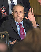 Former United States Senator Bob Dole (Republican of Kansas) arrives for a Congressional Gold Medal ceremony in his honor that is also attended by US President Donald J. Trump in the Rotunda of the US Capitol on Wednesday, January 17, 2017.  Congress commissioned gold medals as its highest expression of national appreciation for distinguished achievements and contributions.  Dole served in Congress from 1961 through 1996, was the Senate GOP leader from 1985 through 1996, and was the 1996 Republican Party nominee for President of the United States.<br /> Credit: Ron Sachs / CNP
