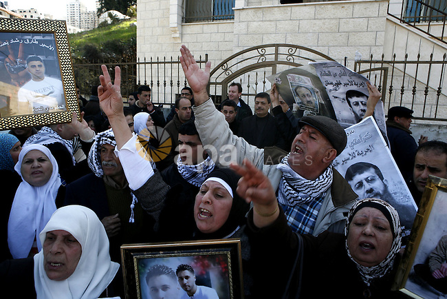 Palestinians hold posters with the image of Khader Adnan, a senior member of Islamic Jihad jailed in Israel who has been on hunger strike for 65 days, during a protest calling for the release of Adnan and other Palestinians who are jailed in Israel, in the West Bank city of Nablus, Sunday, Feb. 20, 2012. Adnan, 33, is on a hunger strike to protest what he says is humiliation that he faces in Israel's military justice system. He is in poor condition and under guard at an Israeli hospital. He is being held in ''administrative detention,'' under which an Israeli military judge can imprison Palestinians for six-month periods without charge. Photo by Wagdi Eshtayah