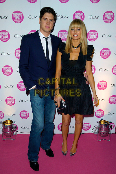 VERNON KAY & TESS DALY.Cosmopolitan Fun Fearless Female Awards 2007 held at Cirque, Leicester Square, London, England. .November 6th 2007 .full length black dress silver clutch bag purse blue suit jacket kaye married husband wife hand in pocket  shoes.CAP/CAN.©Can Nguyen/Capital Pictures
