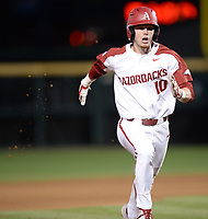 NWA Democrat-Gazette/ANDY SHUPE<br /> Arkansas designated hitter Matt Goodheart heads to third Friday, March 15, 2019, on a fly ball by second baseman Jack Kenley during the fourth inning at Baum-Walker Stadium in Fayetteville. Visit nwadg.com/photos to see more photographs from the game.