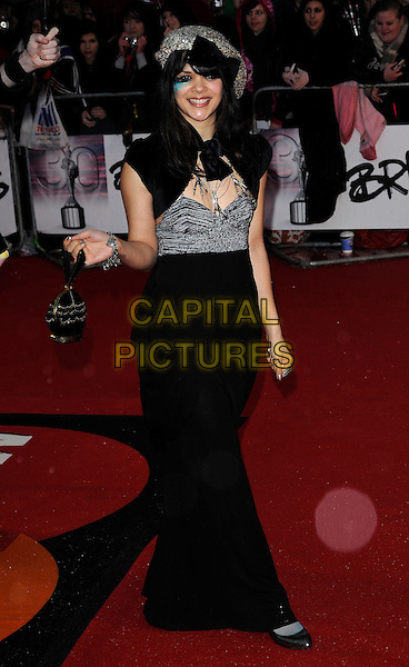 NATASHA KHAN of BAT FOR LASHES .Arrivals the Brit Awards 2010 held at Earls Court, London, England..February 16th 2010 .Brits arrivals full length green eye make-up silver black bag shrug cape dress grey gray bustier sequined sequins hat maxi shoes pointy .CAP/CAN.©Can Nguyen/Capital Pictures.