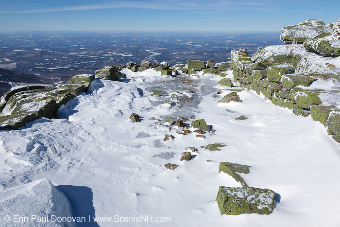 Remnants of the old 1800s Summit House (foundation) on the summit of Mount Lafayette in the White Mountains of New Hampshire. The Appalachian Trail travels across this summit.