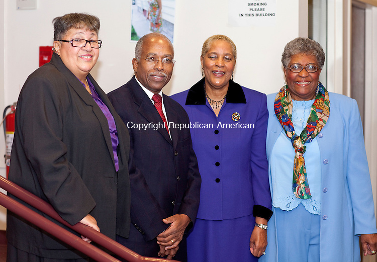 WATERBURY, CT-02 August 2012-120212BF05--  Deborah Fisher from Waterbury, Rev. Larry C. Green, Pastor of Grace Baptist Church, C. Patricia Maness, from Farmington and Bermer Ridenhour during an appreciation dinner honoring Mrs. Martha Reed Price Sunday afternoon at Grace Baptist Church in Waterbury. Mrs. Price, who was not in attendance, has been the organist at Grace Baptist Church for 80 years..Bob Falcetti Republican-American