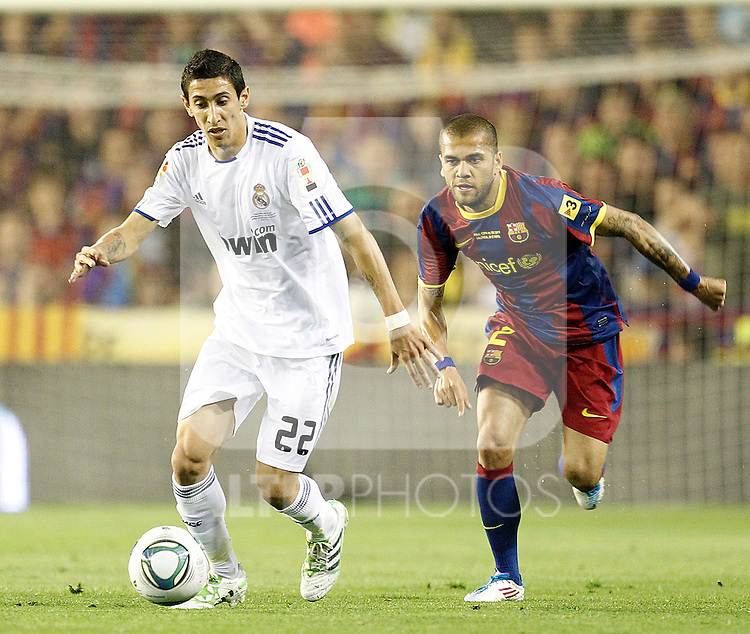 Real Madrid's Angel Di Maria and FC Barcelona's Daniel Alves during la Spain King's Cup Final match in Valencia, Spain on April 20th 2011...Photo: Cesar Cebolla / ALFAQUI