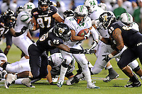 20 December 2011:  FIU linebacker Jordan Hunt (25) and defensive lineman Isame Faciane (99) combine to stop Marshall running back Tron Martinez (2) in the fourth quarter as the Marshall University Thundering Herd defeated the FIU Golden Panthers, 20-10, to win the Beef 'O'Brady's St. Petersburg Bowl at Tropicana Field in St. Petersburg, Florida.
