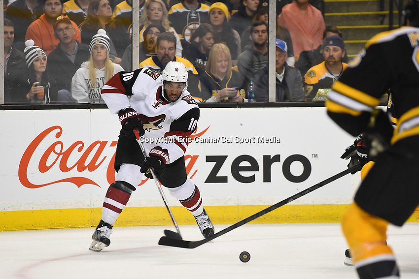 Tuesday, October 27, 2015: Arizona Coyotes left wing Anthony Duclair (10) passes the puck during the National Hockey League game between the Arizona Coyotes and the Boston Bruins held at TD Garden, in Boston, Massachusetts. The Coyotes lose to the Bruins 6-0 in regulation time. Eric Canha/CSM