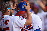 Buffalo Bisons Michael De La Cruz (55) takes the helmet off Reese McGuire (7) after a home run during an International League game against the Syracuse Mets on June 29, 2019 at Sahlen Field in Buffalo, New York.  Buffalo defeated Syracuse 9-3.  (Mike Janes/Four Seam Images)