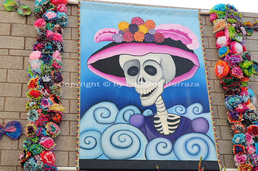 """Mesa, Arizona. October 28, 2012 - The Day of the Dead is a religious holiday celebrated in Mexico with a solemn mood to remember dead loved ones. However, in the Southwest of the United States and in states like Arizona, the holiday takes a form of a cultural festivity, the turning the traditional """"Día de los Muertos"""" into a festival-like event. Artwork by local artists is an essential feature of the Day of the Dead celebrations in the Southwest of the U.S. This tradition can be traced to Mexico's great artist Jose Guadalupe Posada, who painted skulls to criticize dictator Porfirio Díaz and the rich. Photo Eduardo Barraza © 2012"""