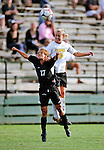 28 August 2009: University of Vermont Catamounts' midfielder/defenseman Alison Hemphill (15), a Junior from Morrisville, VT, jumps higher than Marie-Claude Cyr (17) of the University of Montreal Carabins at Centennial Field in Burlington, Vermont. The Catamounts defeated the Carabins 3-2 in sudden death overtime. Mandatory Photo Credit: Ed Wolfstein Photo