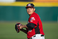 Hickory Crawdads starting pitcher Luis Ortiz (14) warms up in the outfield prior to the game against the Kannapolis Intimidators at L.P. Frans Stadium on April 23, 2015 in Hickory, North Carolina.  The Crawdads defeated the Intimidators 3-2 in 10 innings.  (Brian Westerholt/Four Seam Images)