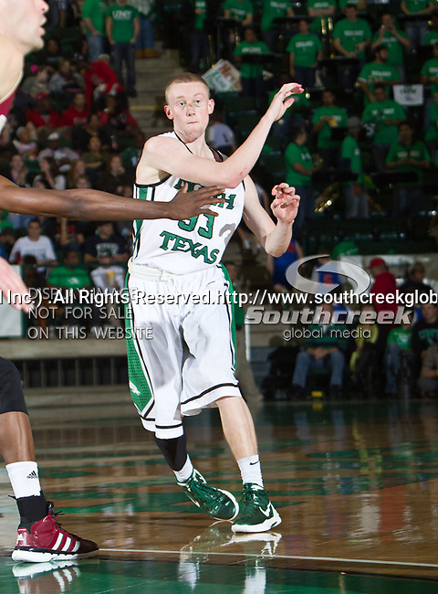 North Texas Mean Green guard Tyler Hall (33) in action during the game between the Denver Pioneers and the University of North Texas Mean Green at the North Texas Coliseum,the Super Pit, in Denton, Texas. UNT defeated Denver 75 to 74 in overtime.