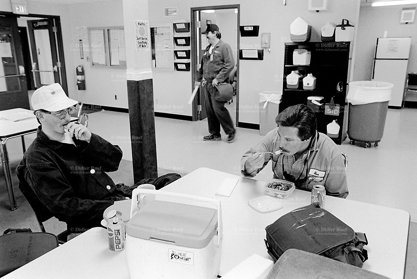 Usa. Utah. Tooele county. Deseret chemical depot. Three workers during lunch time. Tooele chemical agent disposal facility (TOCDF). Program for destruction of chemical weapons and agent. Deseret chemical depot is distant 100 km from Salt Lake City. The Deseret Chemical Depot is one of eight Army installations in the U.S. that currently store chemical weapons. The Tooele Chemical Agent Disposal Facility is designed for the sole purpose of destroying the chemical weapons stockpile located at the depot. © 1998 Didier Ruef