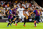 Luis Suarez of FC Barcelona (R) dribbles Geoffrey Kondogbia of Valencia CF (C) during their La Liga 2018-19 match between Valencia CF and FC Barcelona at Estadio de Mestalla on October 07 2018 in Valencia, Spain. Photo by Maria Jose Segovia Carmona / Power Sport Images