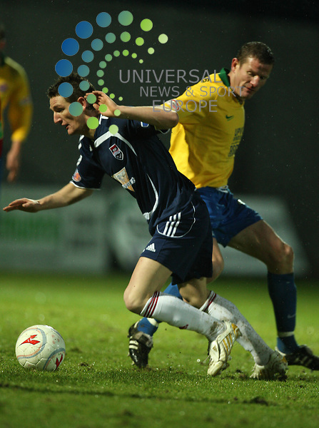 FOOTBALL.Homecoming Scotland Scottish Cup.Ross County v Hamailton Accies.Pictured is .Ross Co player (dk/blue) Steven Craig dodges the challenge of.Hamilton player (yellow) Chris Swailes