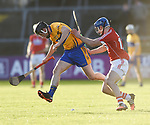 Jack Browne of Clare in action against Robert O Shea of Cork during their Munster Hurling League game at Cusack Park. Photograph by John Kelly.