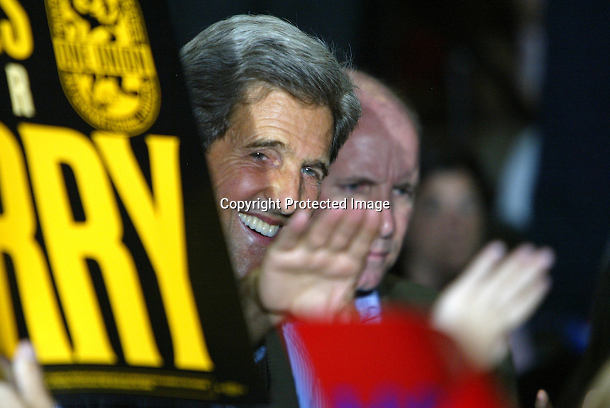 8/10/04,LAS VEGAS,NEVADA ---  U.S. Democratic presidential nominee Senator John Kerry waves to supporters during a visit to Las Vegas on his 'Believe in America' tour at the University of Nevada, Thomas & Mack Center. --- Chris Farina