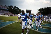 August 30, 2008. Chapel Hill, NC..  In the opening game of the season, the UNC Tarheels beat McNeese State 35- 27 in a game delayed by foul weather.. Players leave the field after lightning struck within a few miles of the stadium.
