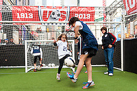 former women's national team player April Heinrichs watches a small sided game during the centennial celebration of U. S. Soccer at Times Square in New York, NY, on April 04, 2013.