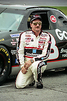Dale Earnhardt poses next to his race car on pit road after Daytona 500 qualifying at Daytona International Speedway, Daytona Beach, Florida, February 1994.  (Photo by Brian Cleary/bcpix.com)