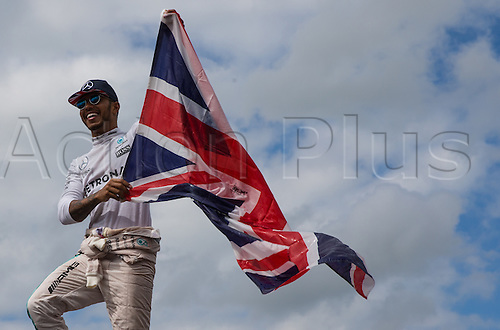 10.07.2016. Silverstone, England. Formula One British Grand Prix, race day.  Mercedes AMG Petronas Formula One Team driver Lewis Hamilton celebrates his win with a union jack flag.
