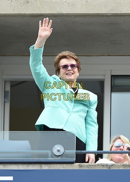 FLUSHING NY- AUGUST 30:  Tennis legend Billie Jean King waves to the crowd during the match at the 2014 US Openon August 30, 2014 in Flushing Queens. <br /> CAP/MPI/MPI04<br /> &copy;MPI04/MPI/Capital Pictures