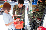 Apr. 19 2010 - BANGKOK, THAILAND: A Thai woman brings food and water to Thai troops on the street in the Silom financial district of Bangkok Monday. Hundreds of Thai soldiers, including reservists and front line units, and riot police moved into the Silom financial district Monday, not far from the red-shirts' main protest rally site, in Ratchaprasong. The heavy show of force is to prevent the Red Shirts from entering the Silom area. Many of soldiers were greeted as heros by workers in the area, who oppose the Red Shirts.   Photo by Jack Kurtz