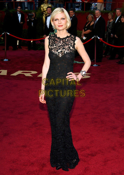 KIRSTEN DUNST.Red Carpet Arrivals, 77th Annual Academy Awards held at the Kodak Theatre, Hollywood, California, USA, .27th February 2005.  .oscars full length black dress lace sheer top see through see-through thru hand on hip bob bobbed hair.Ref: ADM.www.capitalpictures.com.sales@capitalpictures.com.©JWong/AdMedia/Capital Pictures