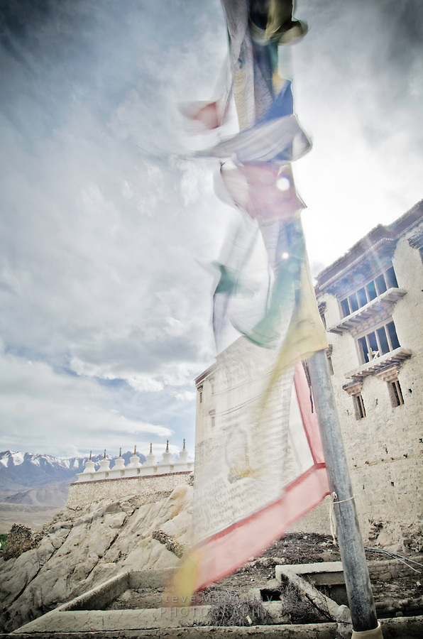 Prayer flags fluttering in the breeze at Shey Palace, Naropa Royal Palace, in Ladakh, India.