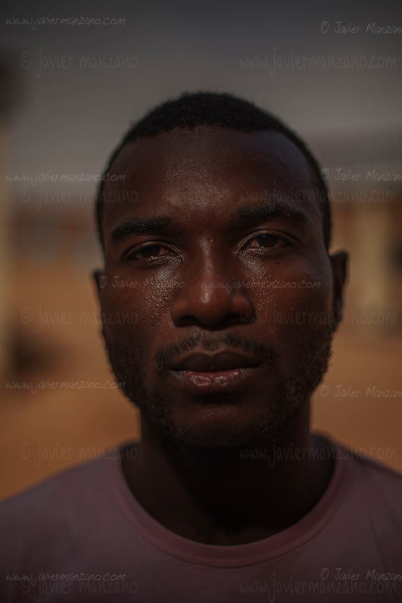 AGADEZ, NIGER &mdash; <br /> <br /> 23-year-old Mpoma Bedding Chovis is a native of Cameroon. He worked as a construction worker in his native country but dreams of becoming a professional soccer player. He tried out for division one in Cameroon but said that he was cheated on several occasions by would-be soccer recruiters. &quot;My only dream is to become a professional footballer.&quot; <br /> The convoy he was riding in through the Sahara desert ran into a police check-point outside the city of Arlit in north Niger. He and 8 other migrants from Cameroon were  robbed of all their money by the police. He is now hoping to find someone to help him return to Cameroon.
