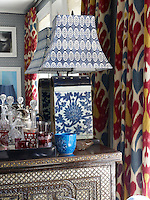 Objects arranged on the antique cabinet in a corner of the living room display a variety of patterns and textures