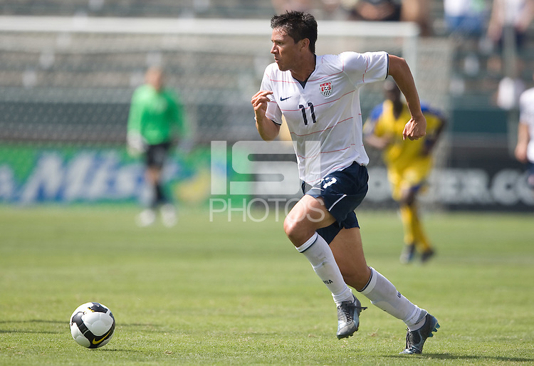 Brian Ching carries the ball, USA 8-0 over Barbados during the first round of World Cup Qualifying, Sunday, June 15, 2008, in Carson, California.