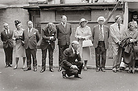 waiting for royalty at Toynbee Hall, Aldgate, John Profumo kneeling