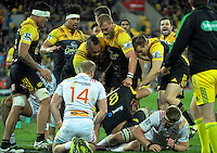 Hurricanes players congratulate Victor Vito on his try during the Super Rugby semifinal match between the Hurricanes and Chiefs at Westpac Stadium, Wellington, New Zealand on Saturday, 30 July 2016. Photo: Dave Lintott / lintottphoto.co.nz