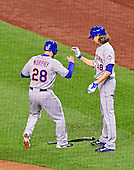 New York Mets second baseman Daniel Murphy (28) is congratulated by pitcher Jacob DeGrom (48) after scoring his team's first run in the second inning against the Washington Nationals at Nationals Park in Washington, D.C. on Wednesday, April 8, 2015.<br /> Credit: Ron Sachs / CNP<br /> (RESTRICTION: NO New York or New Jersey Newspapers or newspapers within a 75 mile radius of New York City)