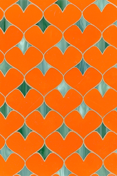 Hearts, a glass waterjet mosaic shown in Stella and Peacock Topaz, is part of the Erin Adams Collection for New Ravenna.